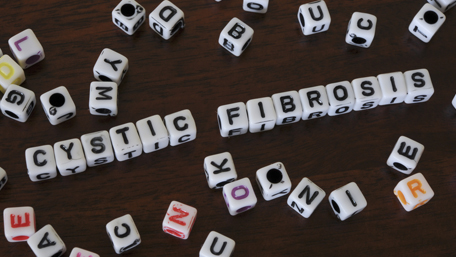 Cystic Fibrosis spelled out on die