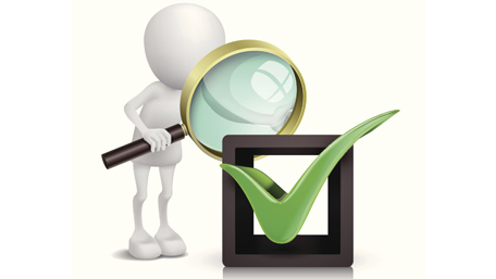 figure looking through magnifying glass at a checkmark